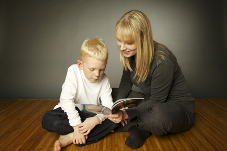 Rebecca reading book with a child